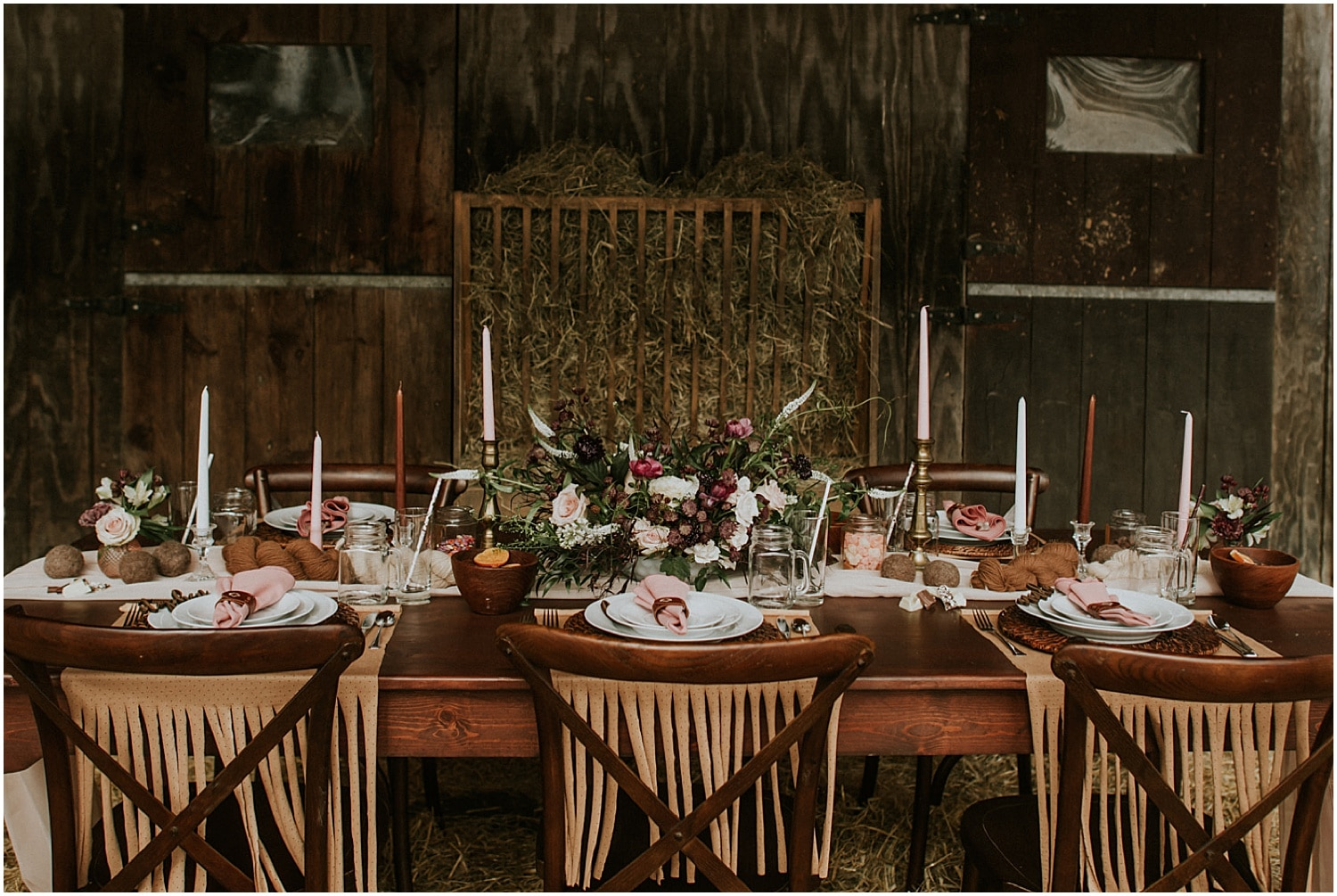 table set up in the barn of this alpaca Farm Elopement Inspiration