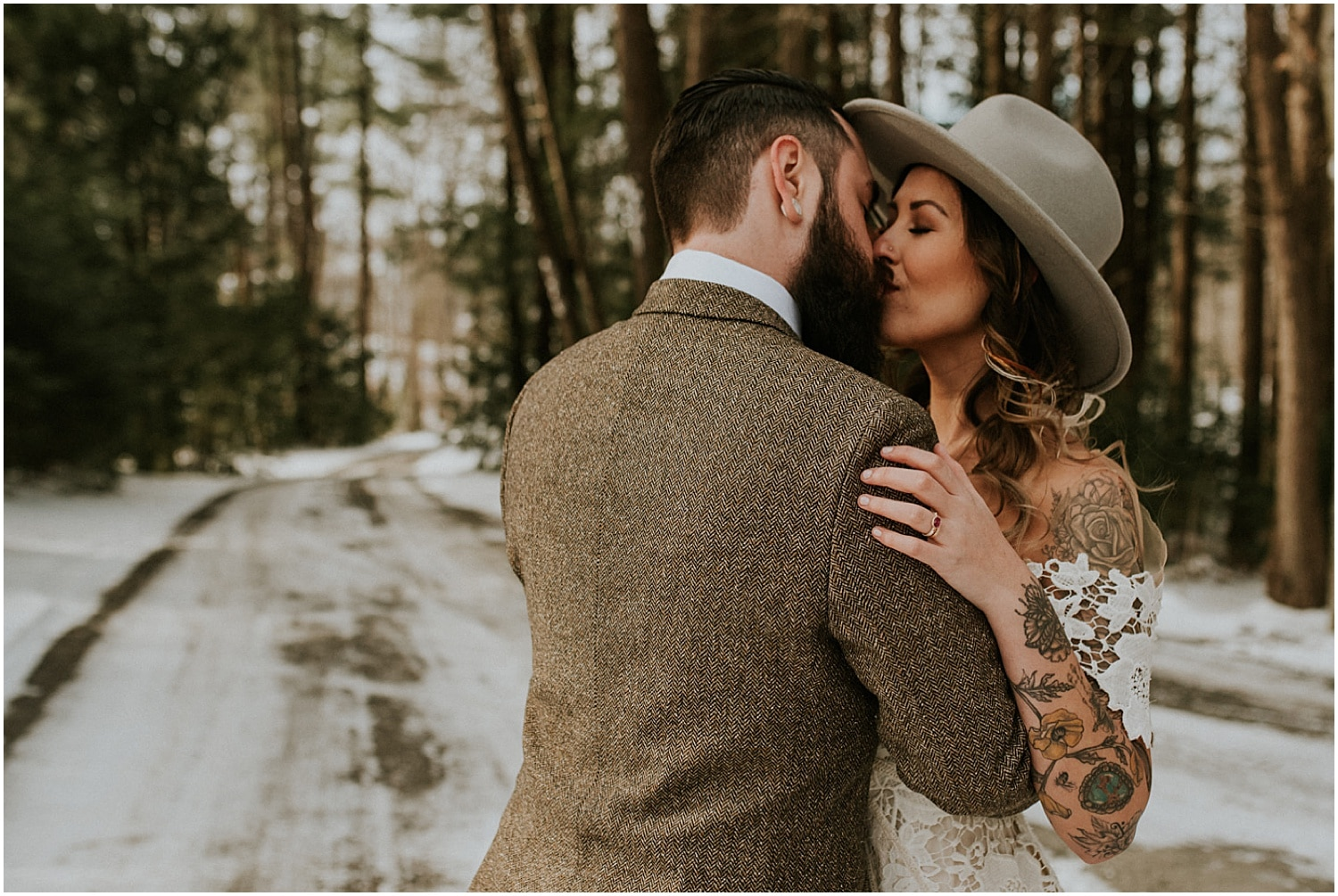 bride and groom dancing in the snowy scape at this farm elopement inspiration