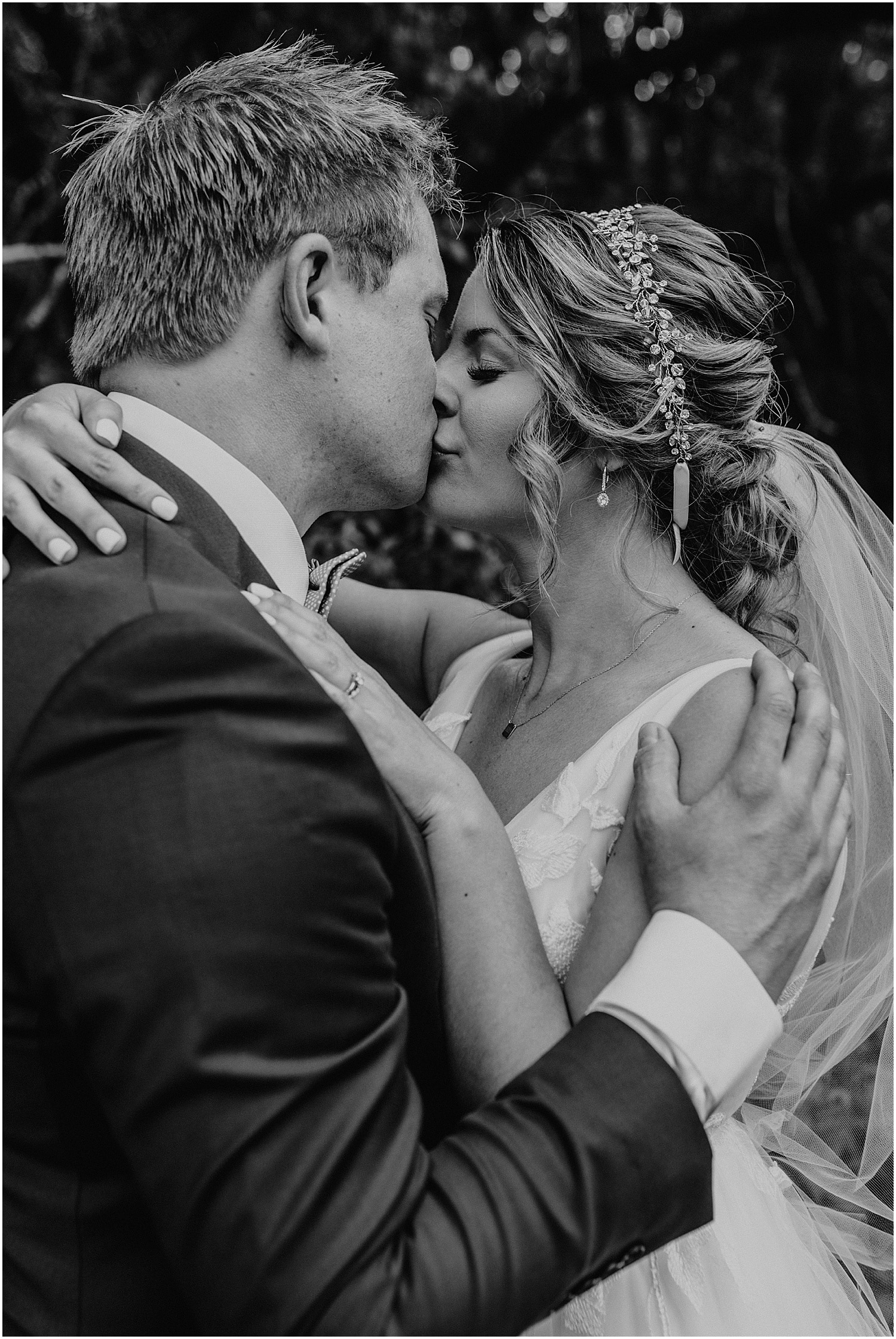 black and white of bride and groom kissing at their Barn at Silver Oaks Wedding