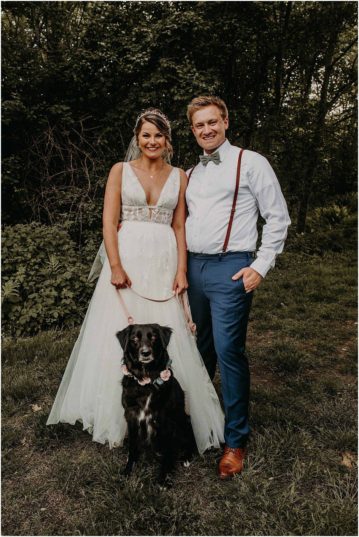 bride and groom with their dog at their Barn at Silver Oaks Wedding