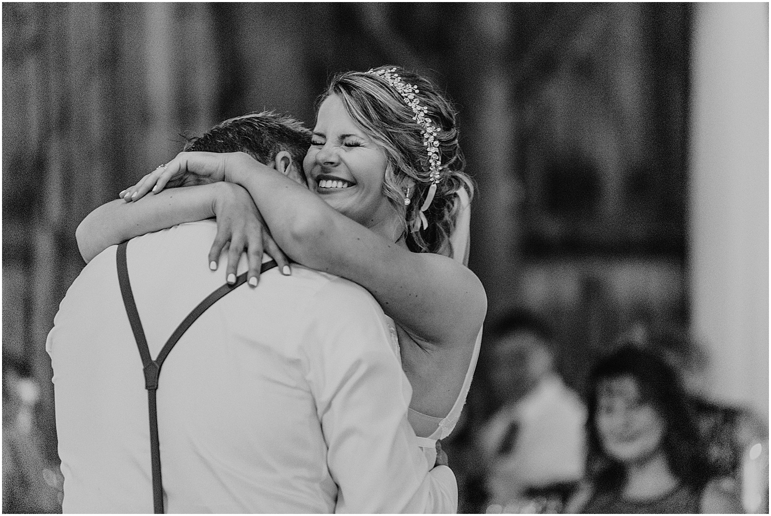 black and white of bride and groom hugging during their first dance at Barn at Silver Oaks Wedding