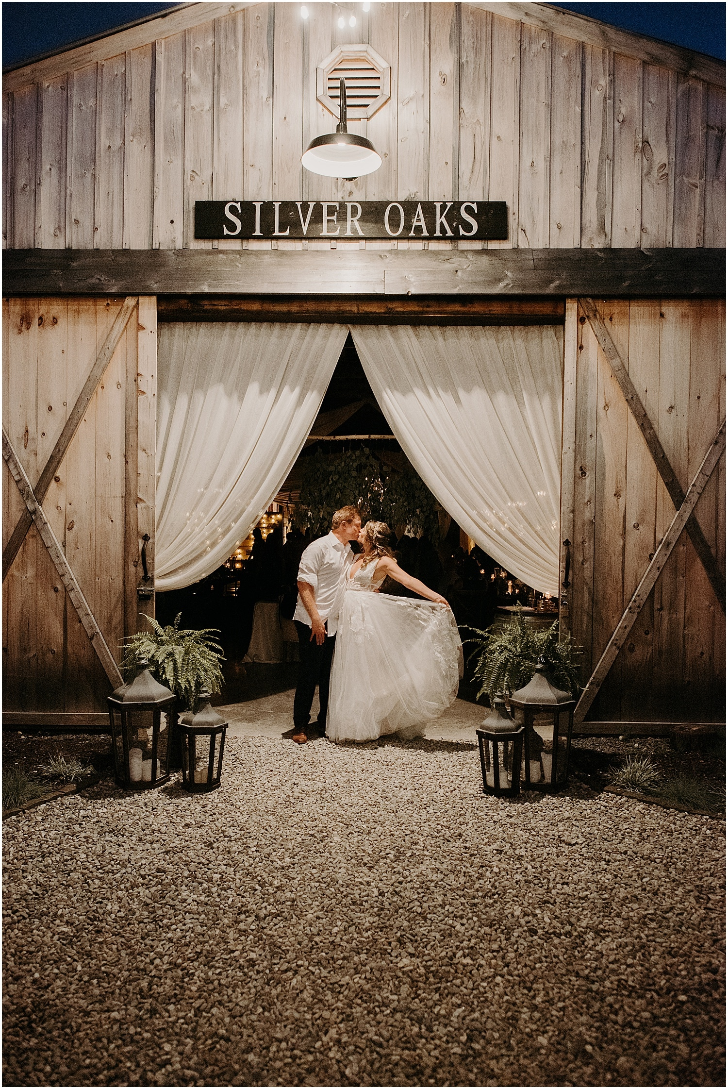 Barn at Silver Oaks Wedding bride and groom kissing in the barn