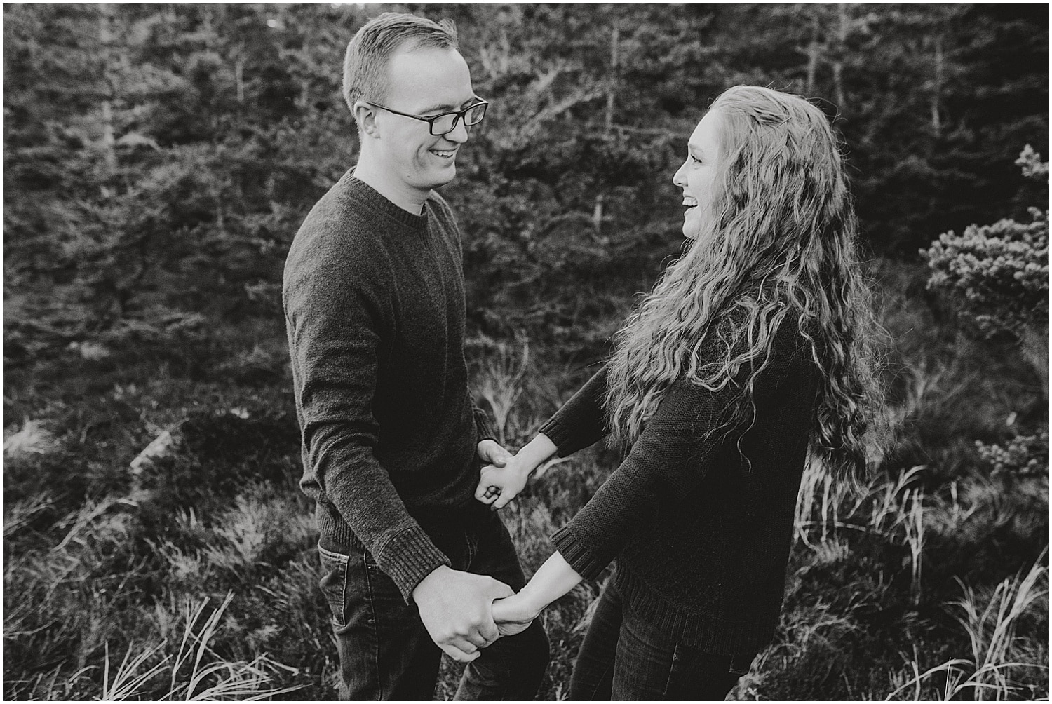 black and white of couple laughing during their eastern maine engagement session