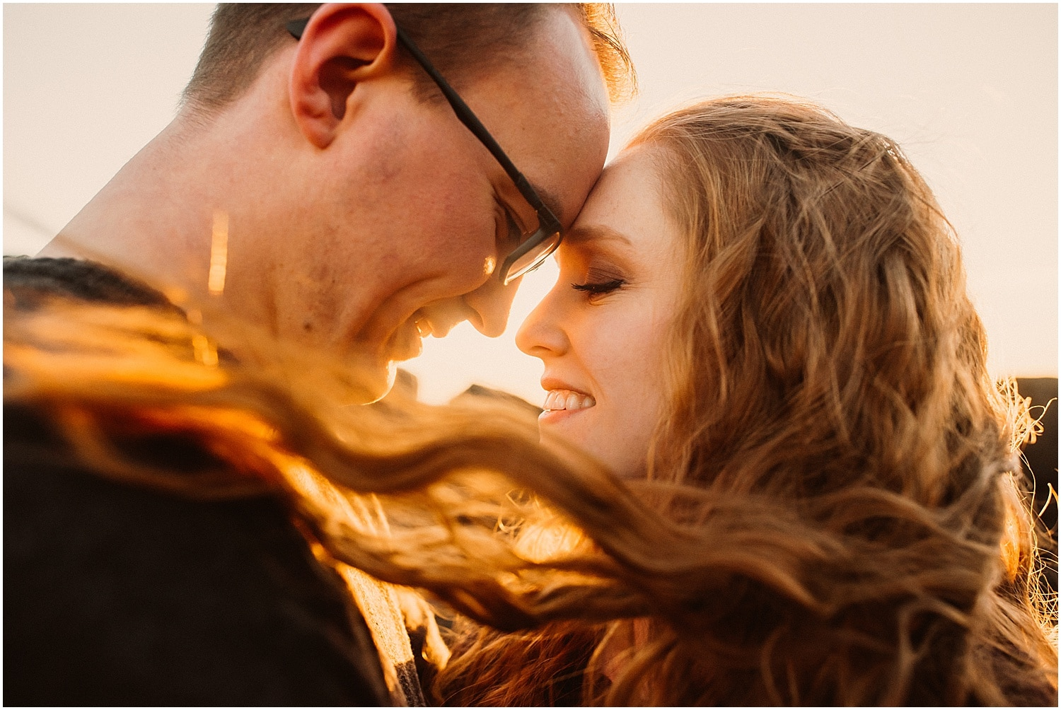 sunset photos of couples forehead to forehead