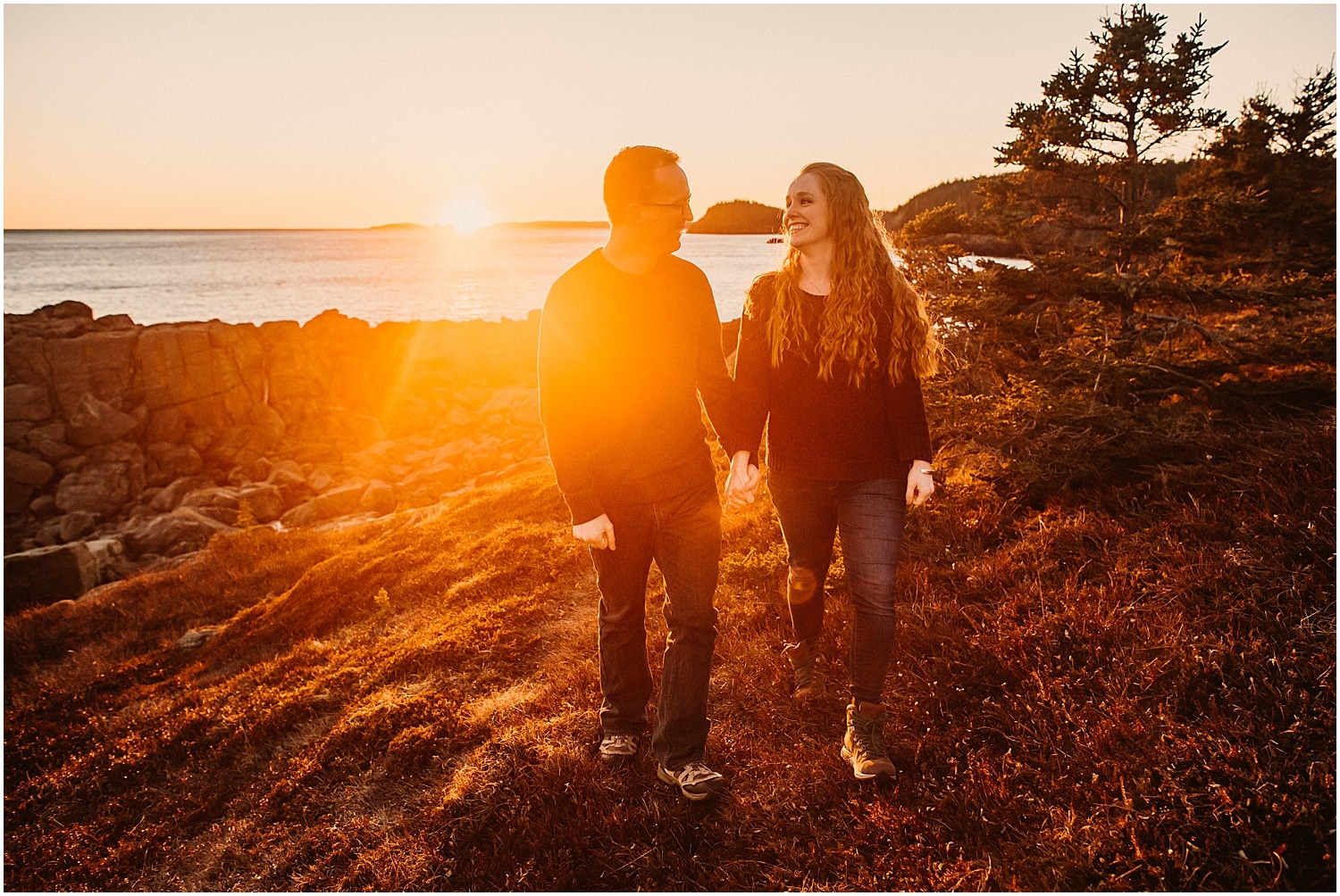 couple walking during the sunset in eastern maine