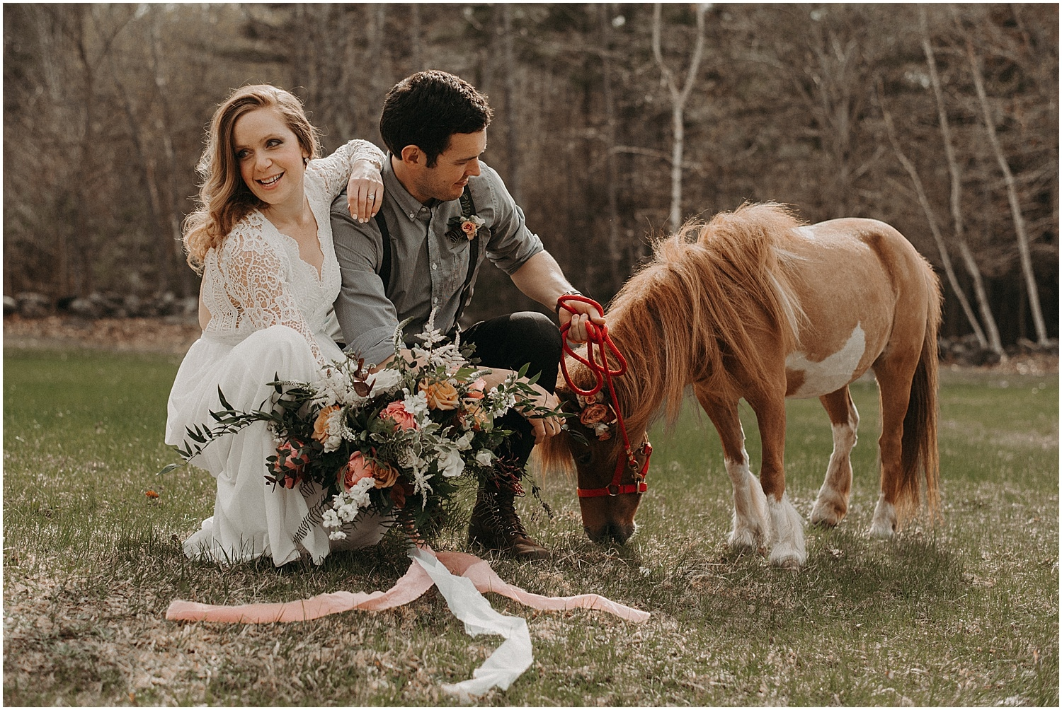 bride and groom interacting with miniature horses with a bouquet
