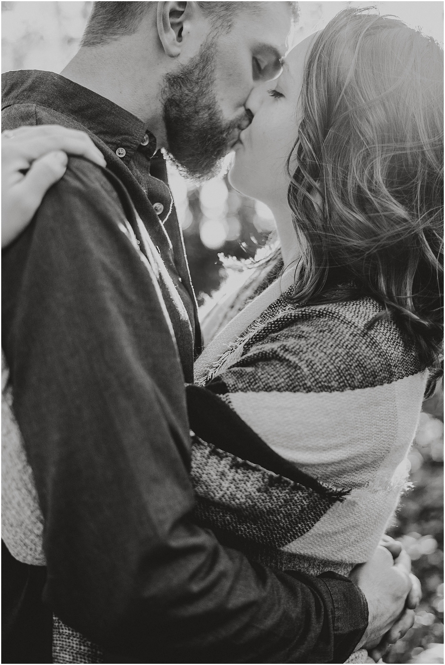black and white couple kissing during their fall engagement photos in rockland maine
