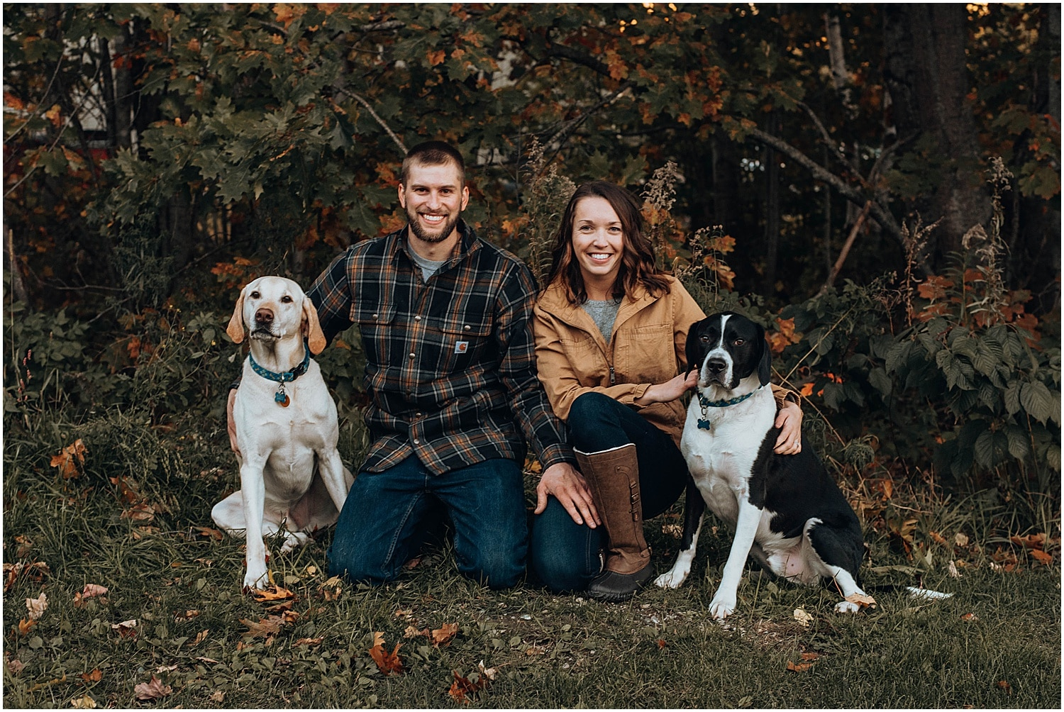 couple with their dogs during their engagement session