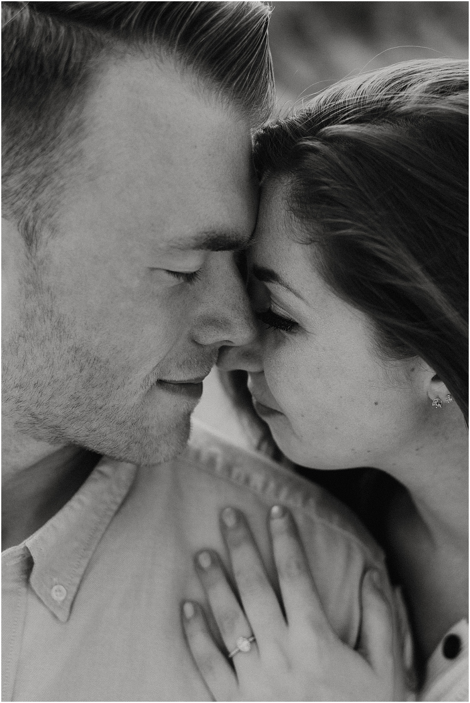 close up blak and white of man and woman forehead to forehead at their Ferry Beach Engagement photo session
