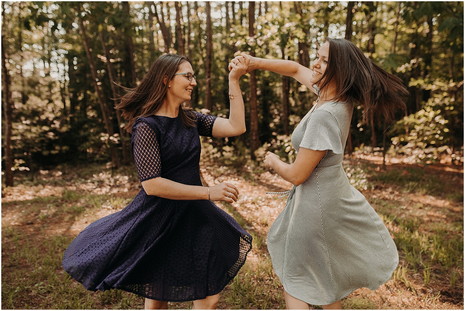 two women making their dresses twirl at their Pineland Farms Engagement session