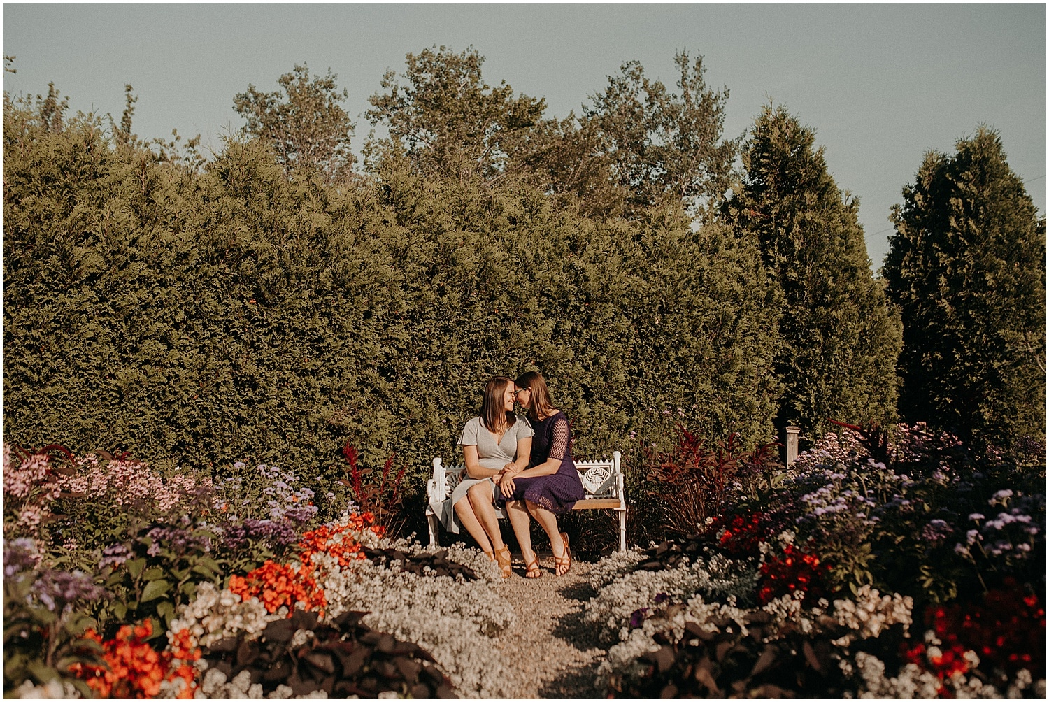 lgbt couple snuggling during their Pineland Farms Engagement session