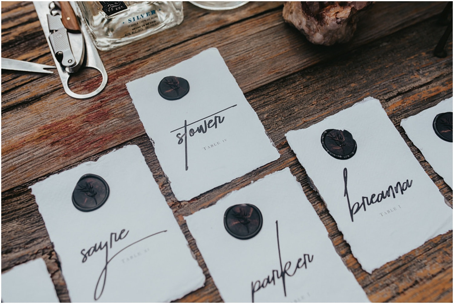 dark gothic table goods on a natural wood table at this halloween wedding inspiration
