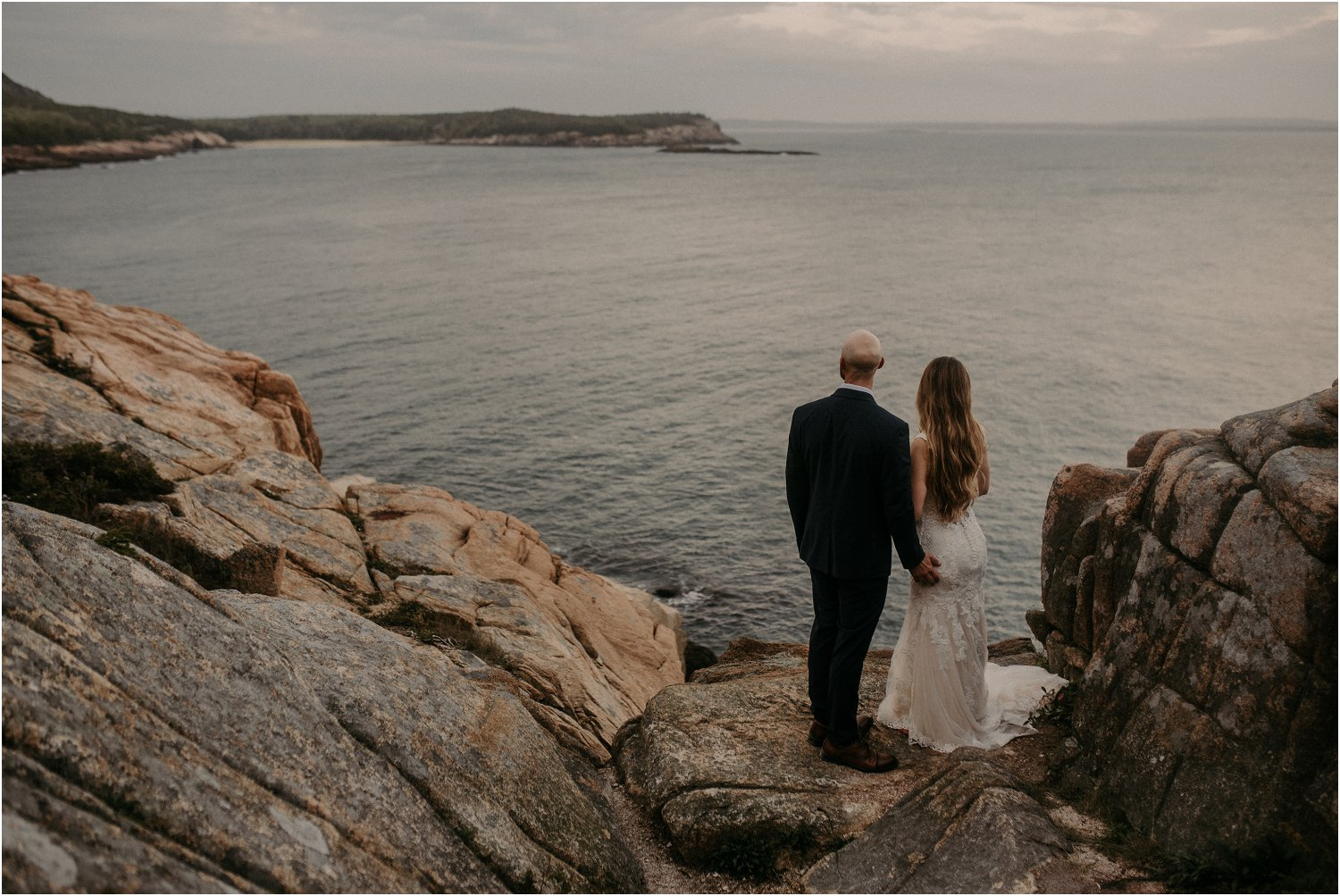 bride and groom at otter cliff acadia national park